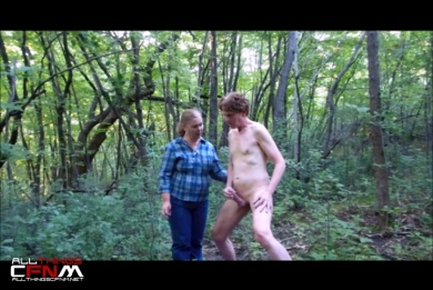 Older woman teases & kisses man jacking in woods CFNM video